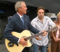 Bush plays guitar